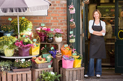 Small Business Owner in front of flower shop